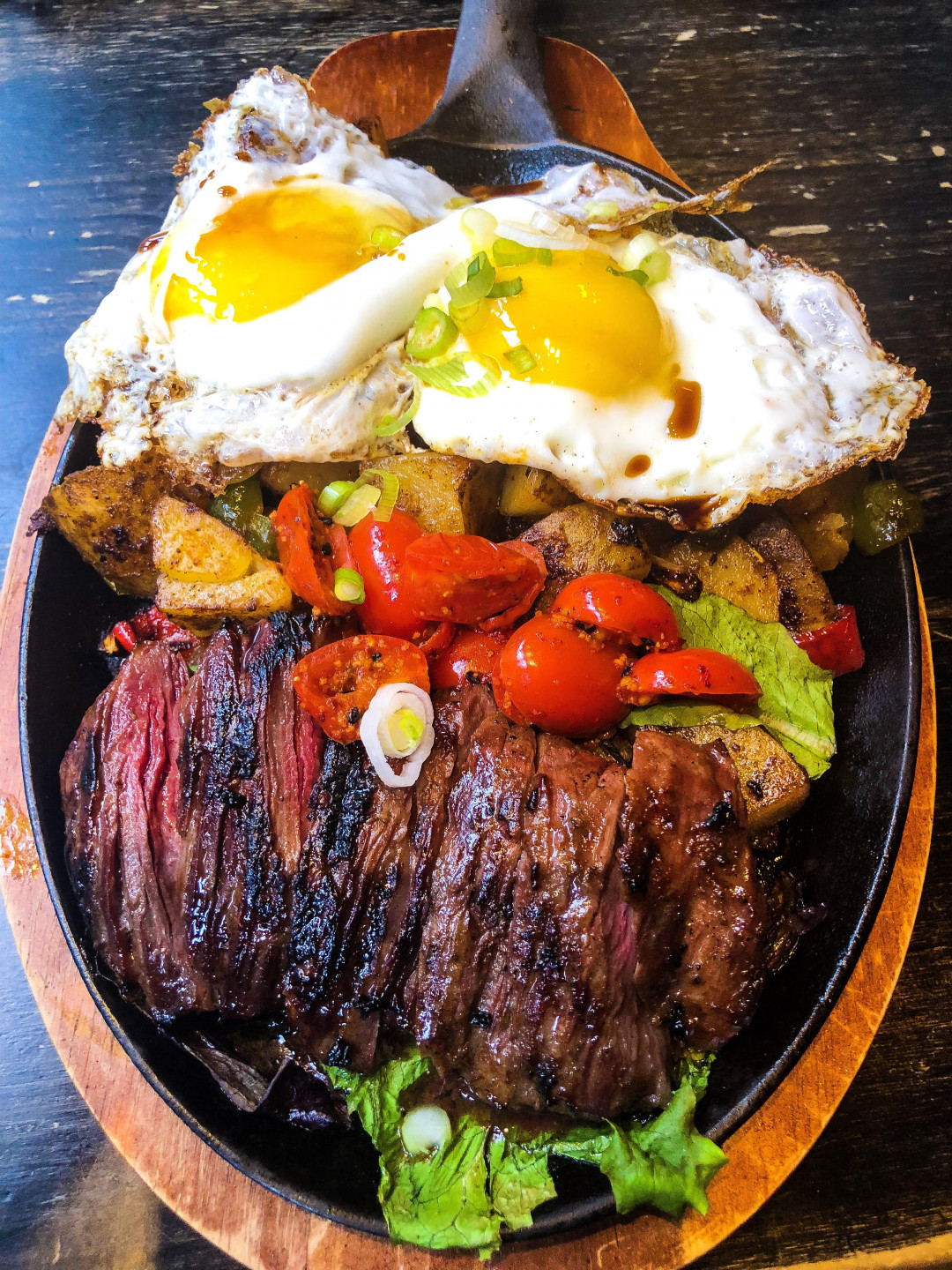 This Is The Steak Eggs Platter With Vietnamese Buttered Skirt Steak With 2 Sunny Side Eggs